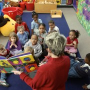 MR / Schenectady, NY Yates Arts-in-Education Magnet School                Full day pre-K class; urban public school                State funding thru NYS Universal Pre-K Program Teacher reads book to class at storytime.   MR: AE-pkf, Fel2 ©Ellen B. Senisi