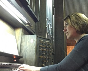Julia playing organ at American Reformed Church; photo by Lyle Huisman