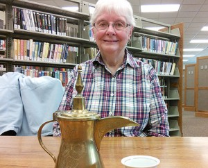 Phyllis Vander Werff with an Arab-style coffee pot and cup from Kuwait; photo by Anna Bartlett